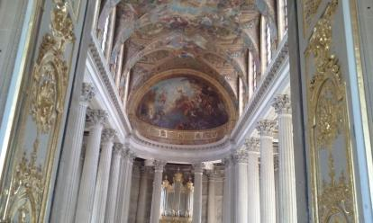 The Chapel at Versailles. The walls are filled with ornate work throughout the palace.
