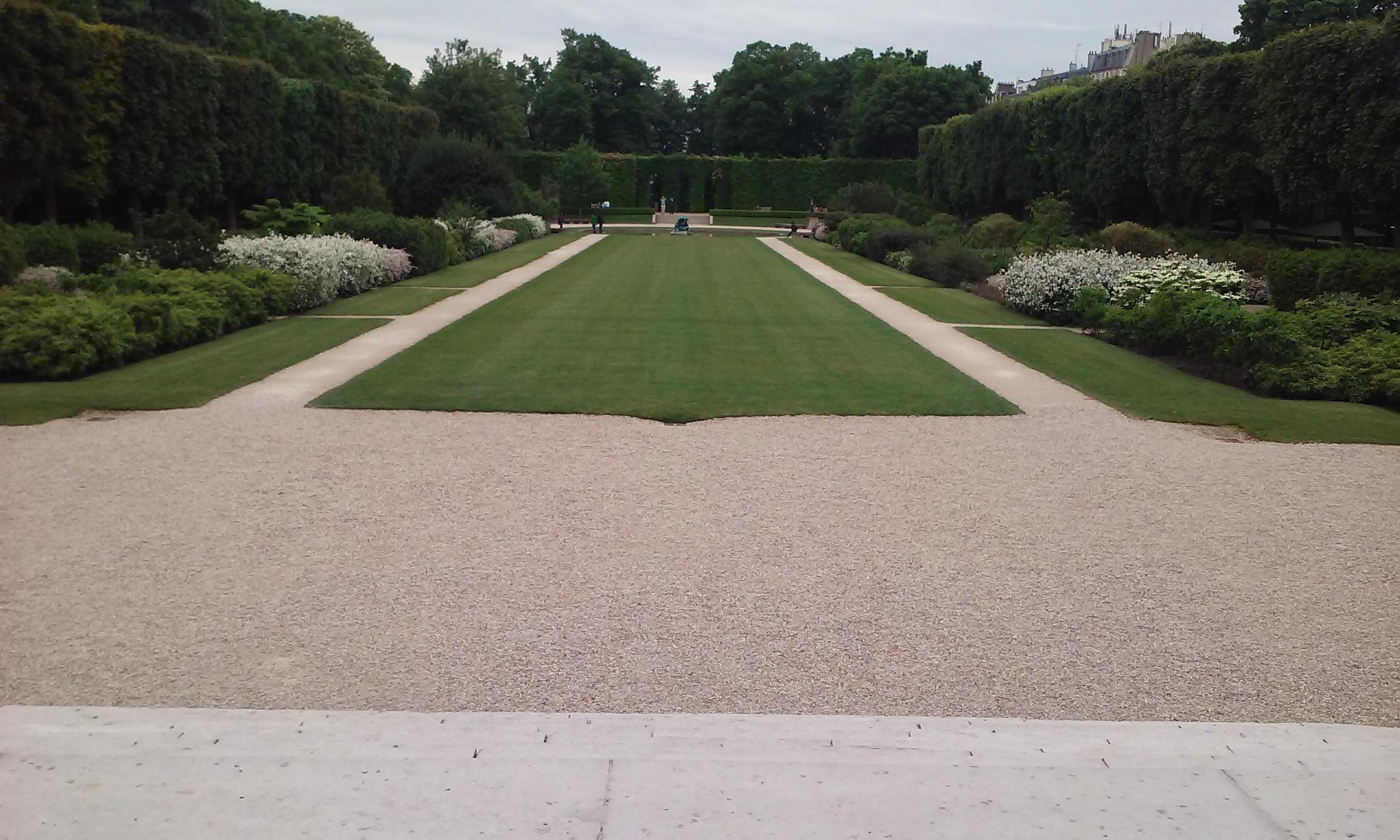 The Central garden at the Musee Rodin. There are a few statues at the end of the walkway a