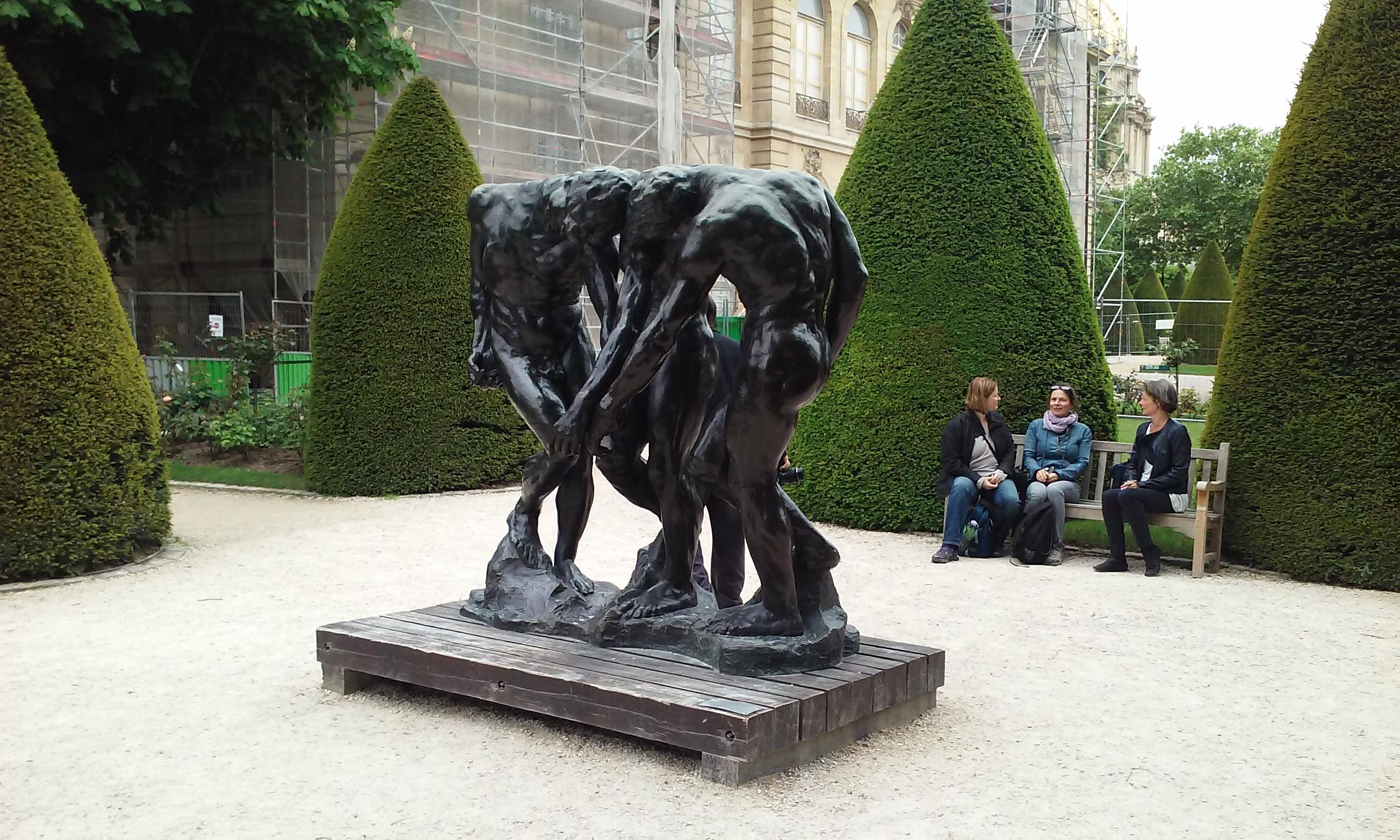 A statue showing shared agony at the Musee Rodin.  The museum has several benches to enjoy