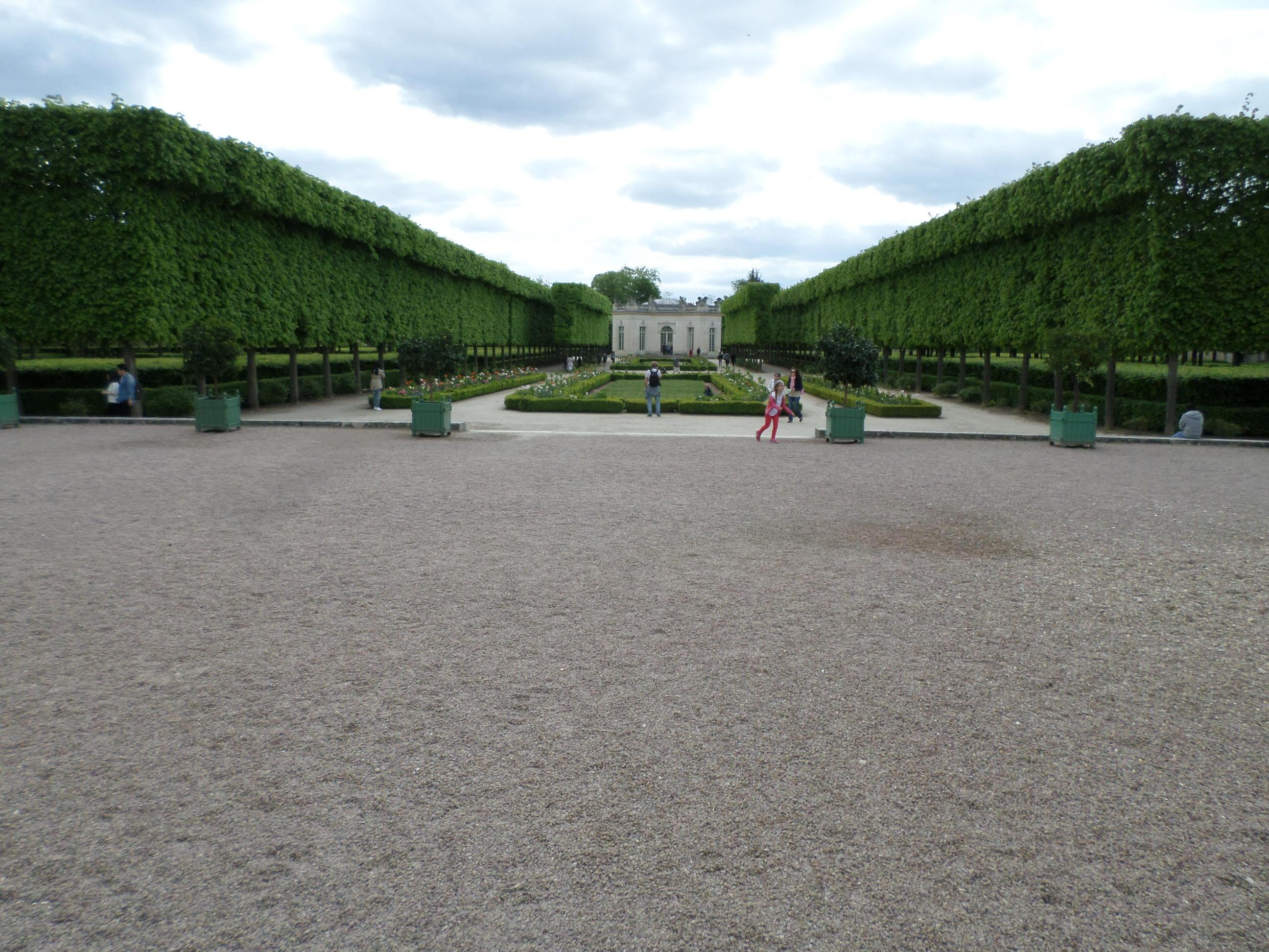 Palace of Versailles.  Petit Trianon symmetric gardens. It would take at least a day to wa